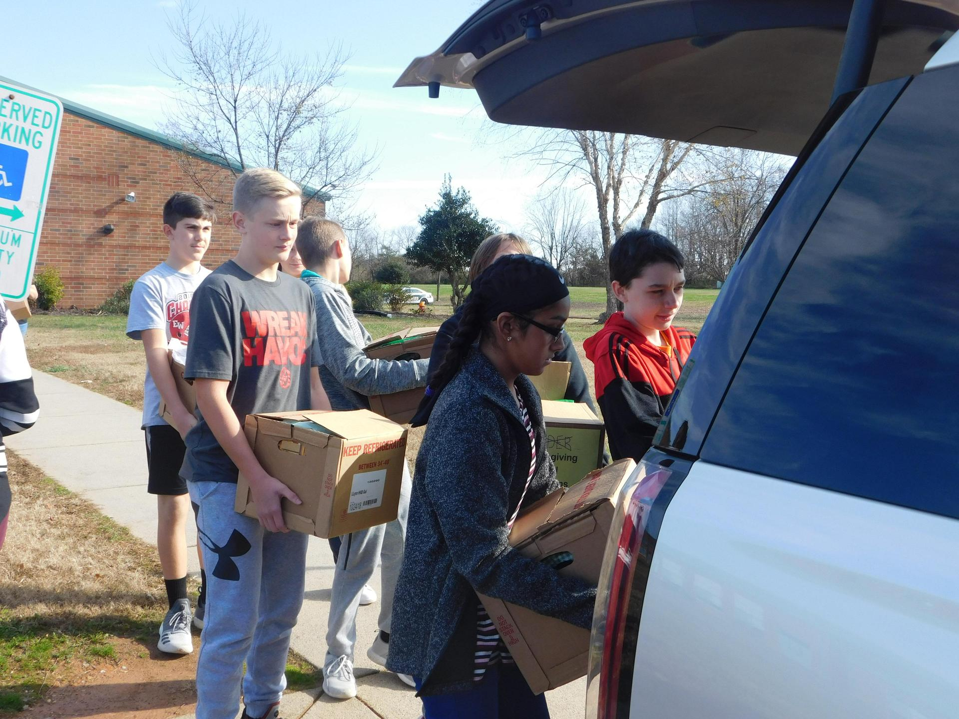 Student load car with boxes.