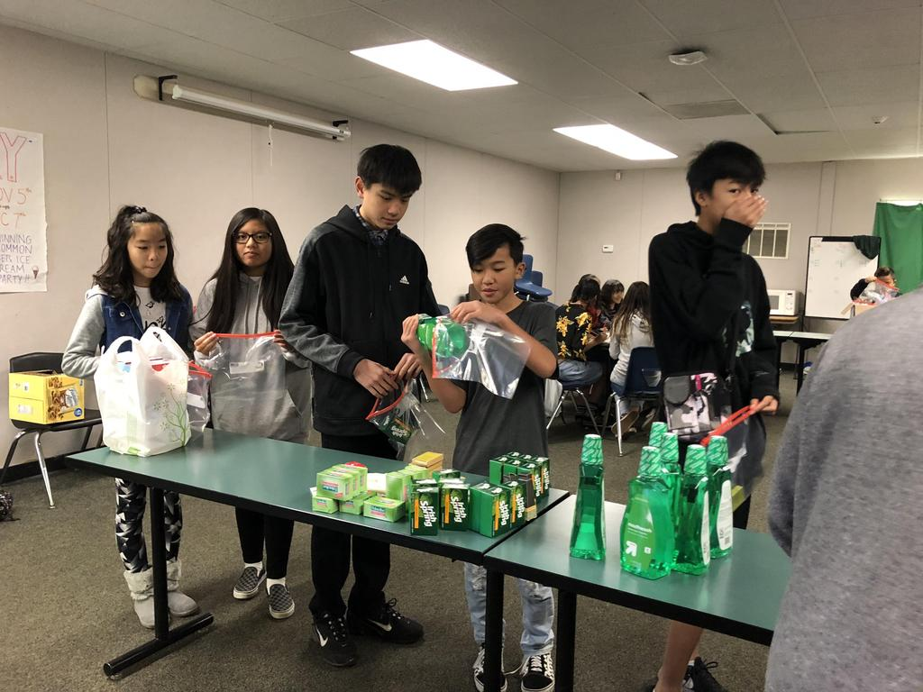 CCA students packing toiletries into bags for the homeless.
