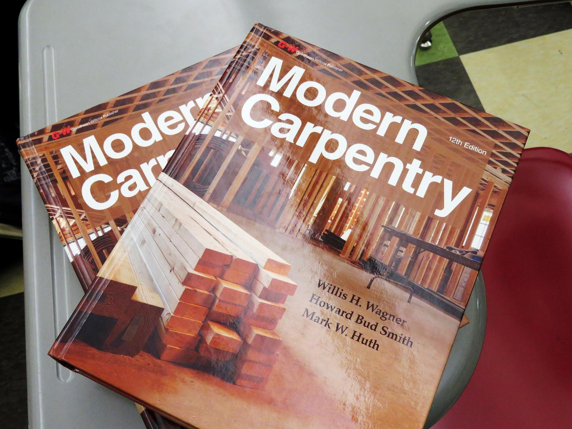 A close-up of two Modern Carpentry textbooks