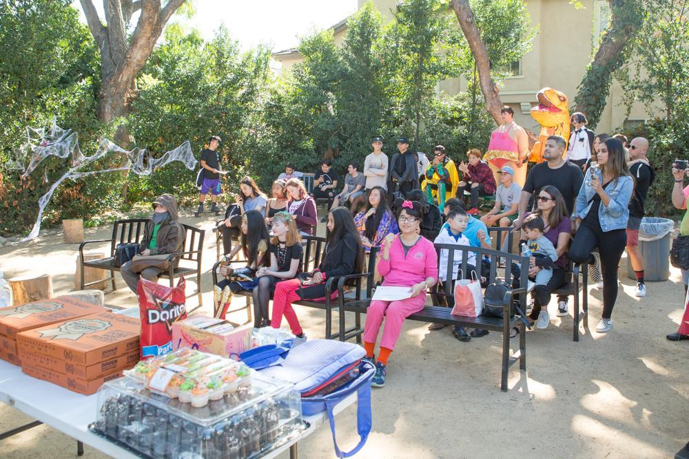 Students sit in the outdoor classroom for one of our End of the Month Celebrations. This was in October so many students are wearing costumes