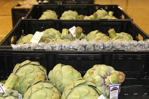 photo of artichokes in bins