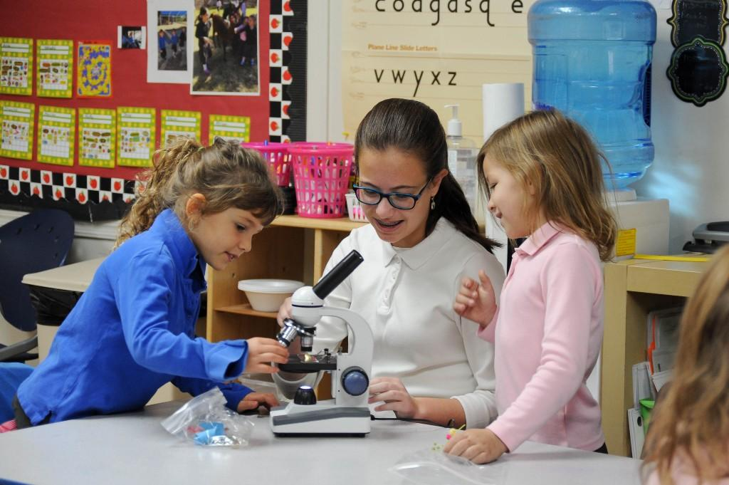 Girls using microscopes