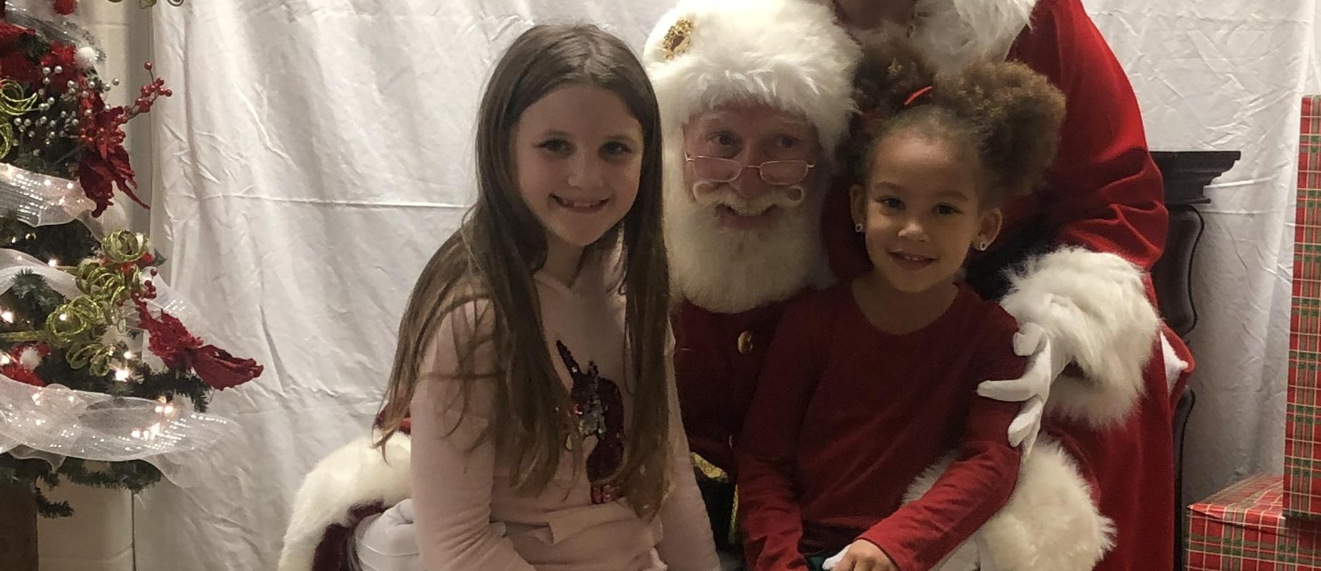 Santa with two students