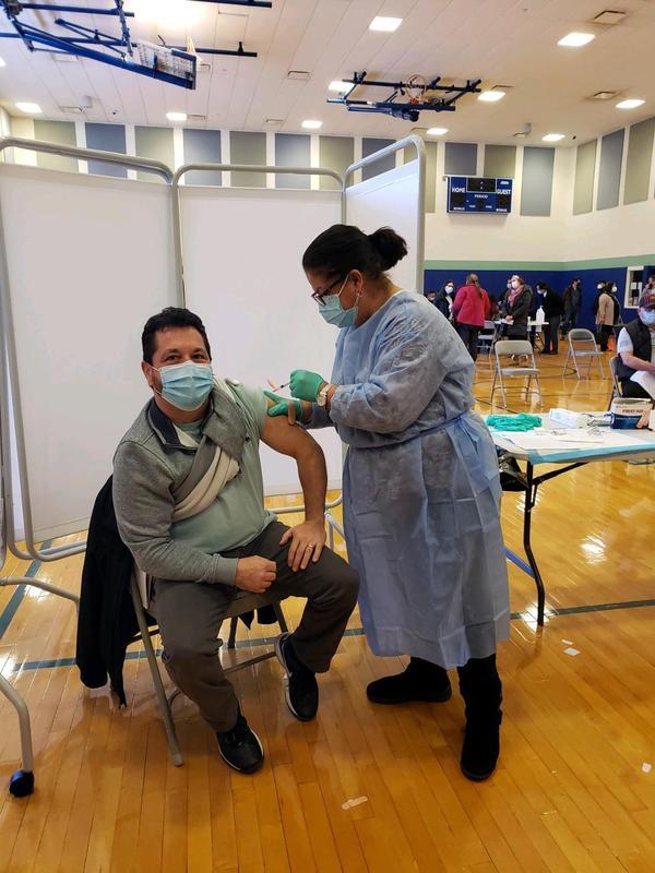Michael Celebrano getting vaccine