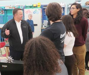 Exelon Generation Northeast Region General Manager Archie Gleason talks to students after his company donated close to $13,000 worth of robotics kits to the EHS Science Department.
