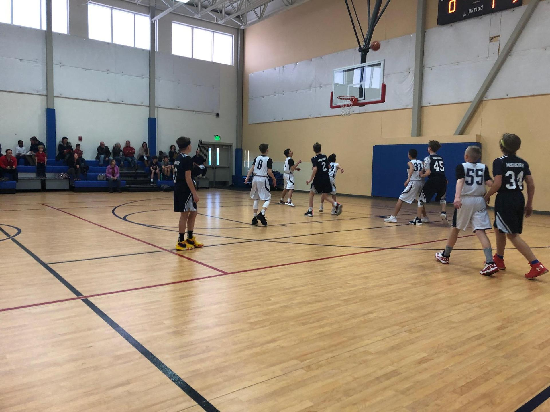 boys basketball playing defense