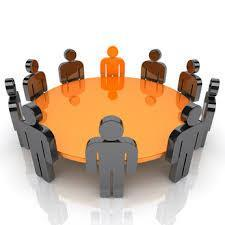 Graphic illustration of a round table where people figures are sitting in a meeting.
