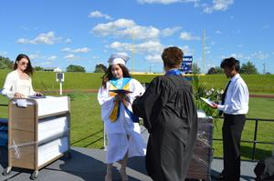 Salutatorian Amy Truong walks up the ramp to receive her diploma