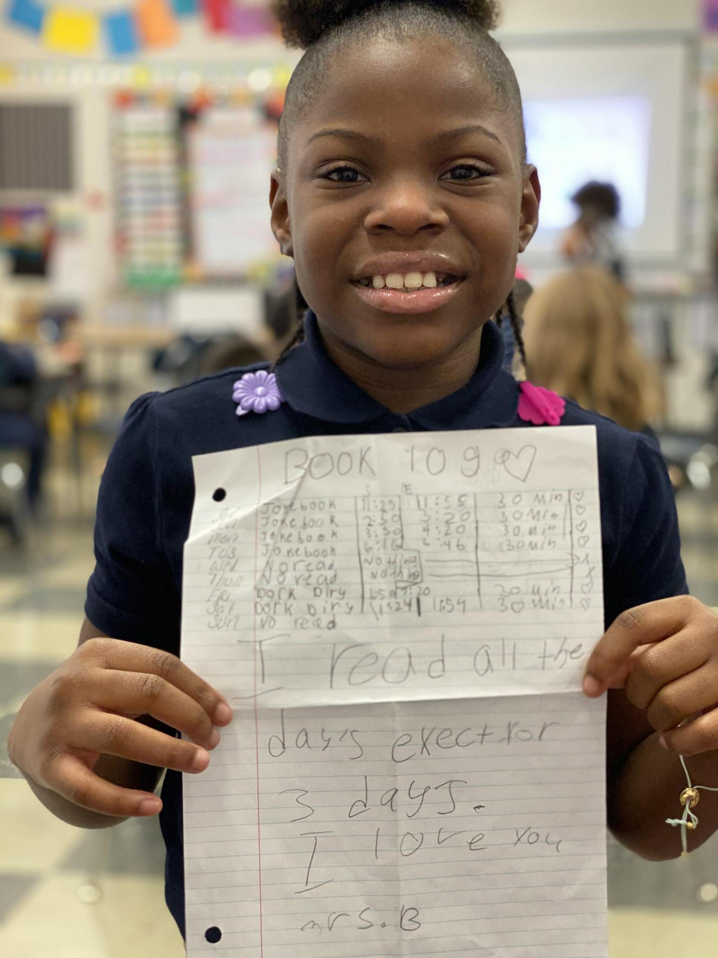 Student writes message to her teacher