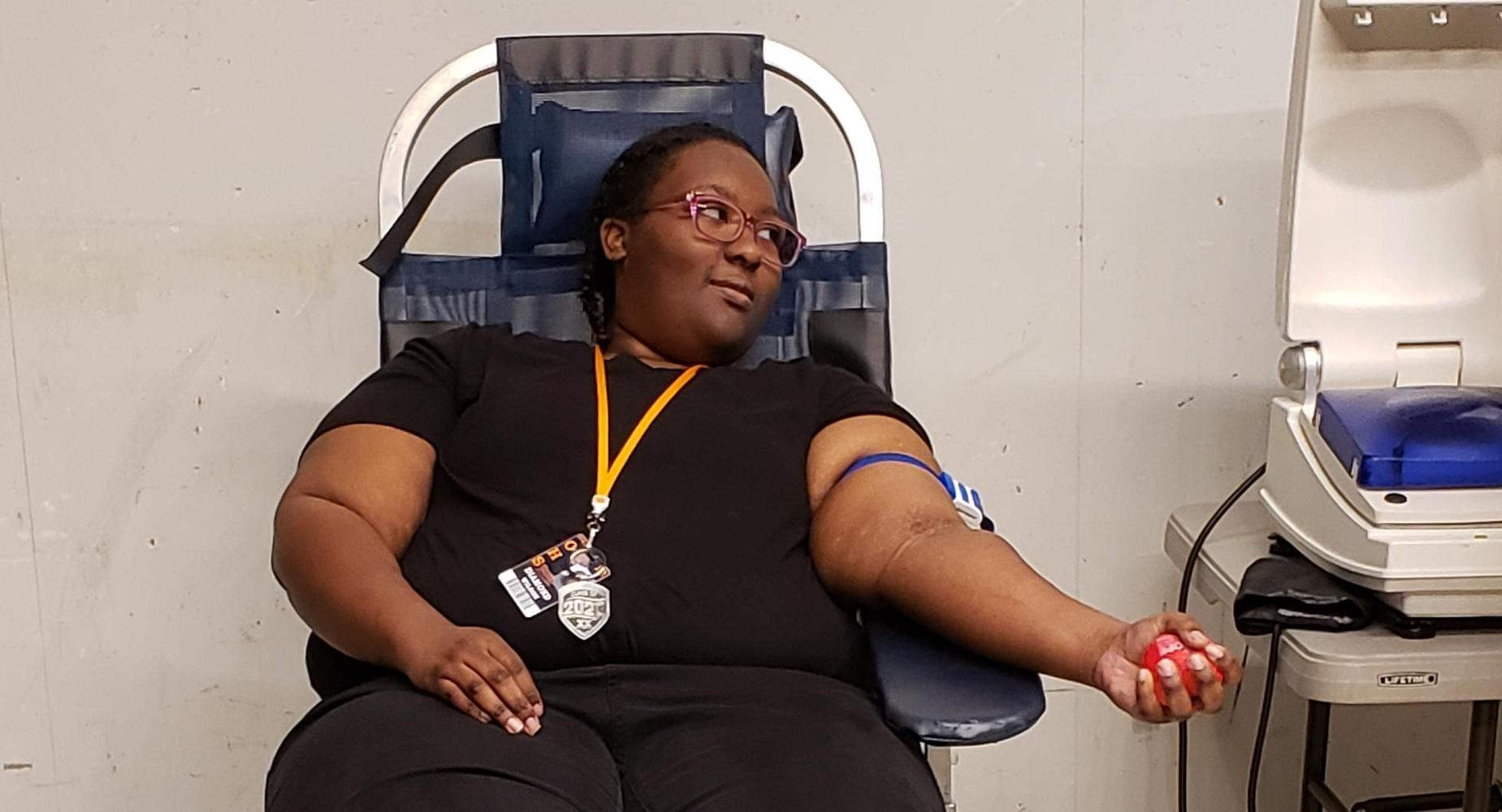 Diamond Wilson prepares to donate blood.