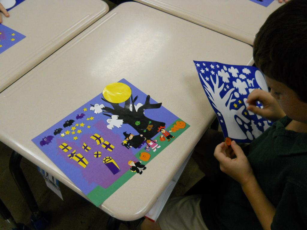 Kindergarten making Halloween page.