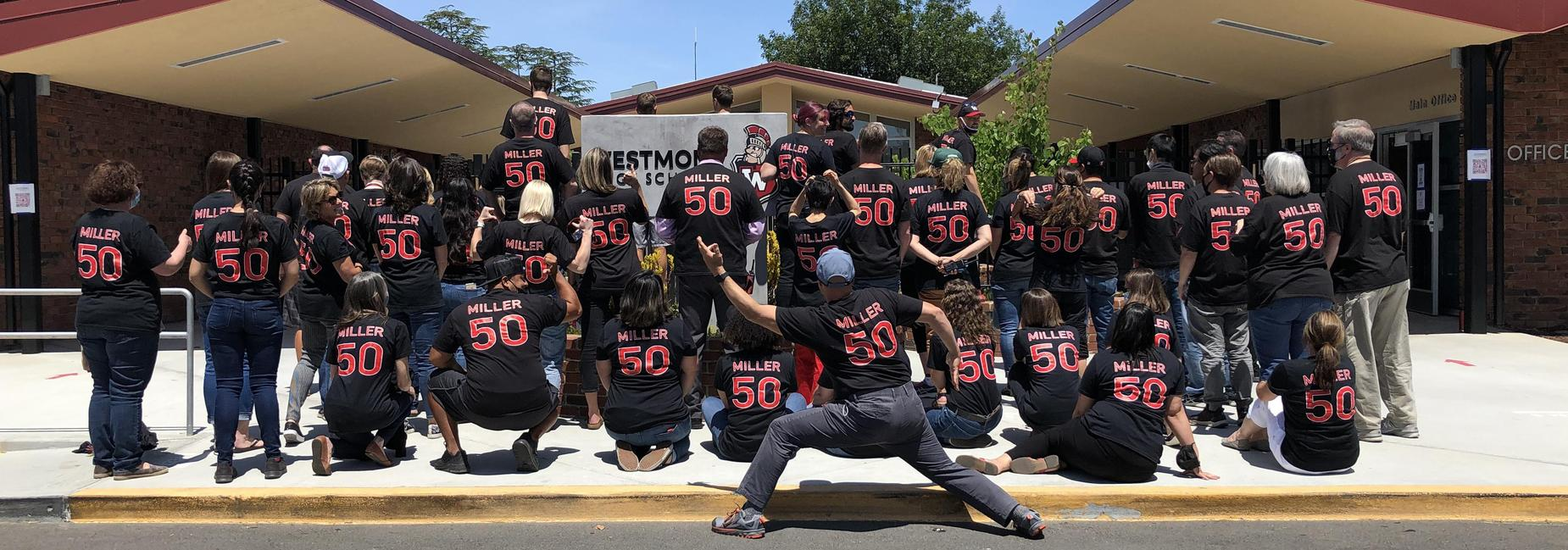Westmont staff wearing matching shirts that say Miller #50 on the back to celebrate Principal Miller's 50th birthday.