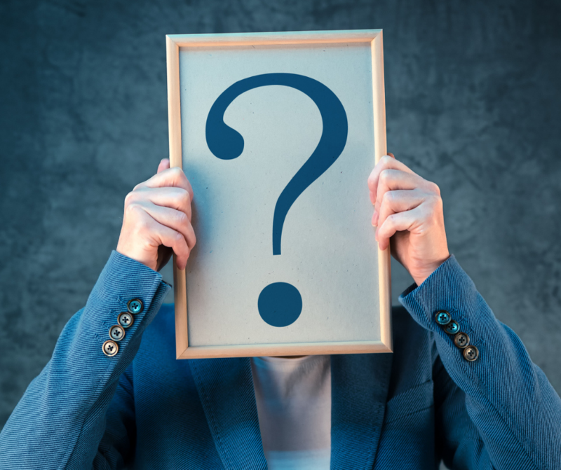 photo of woman holding question mark