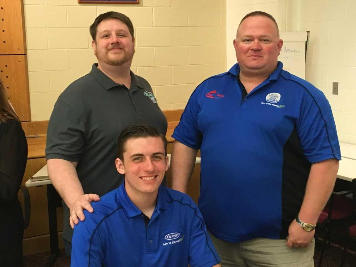 HVAC student with employer and teacher