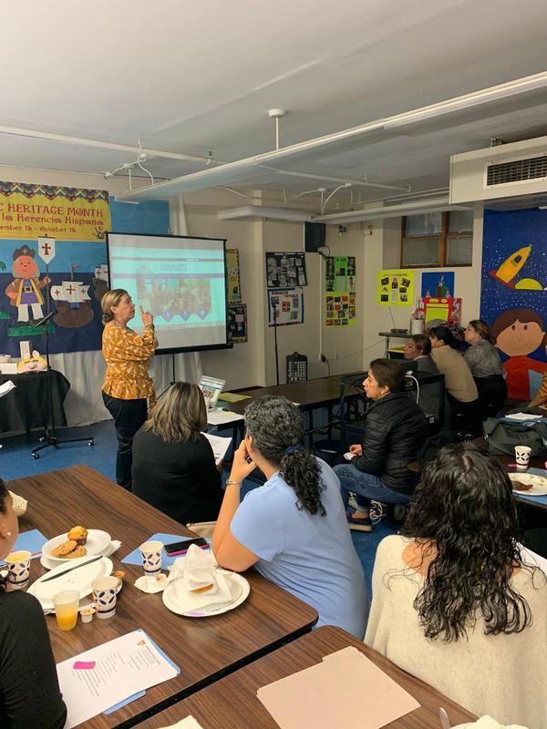 Maria Valente tech facilitator explaining Parent Portal to Parents