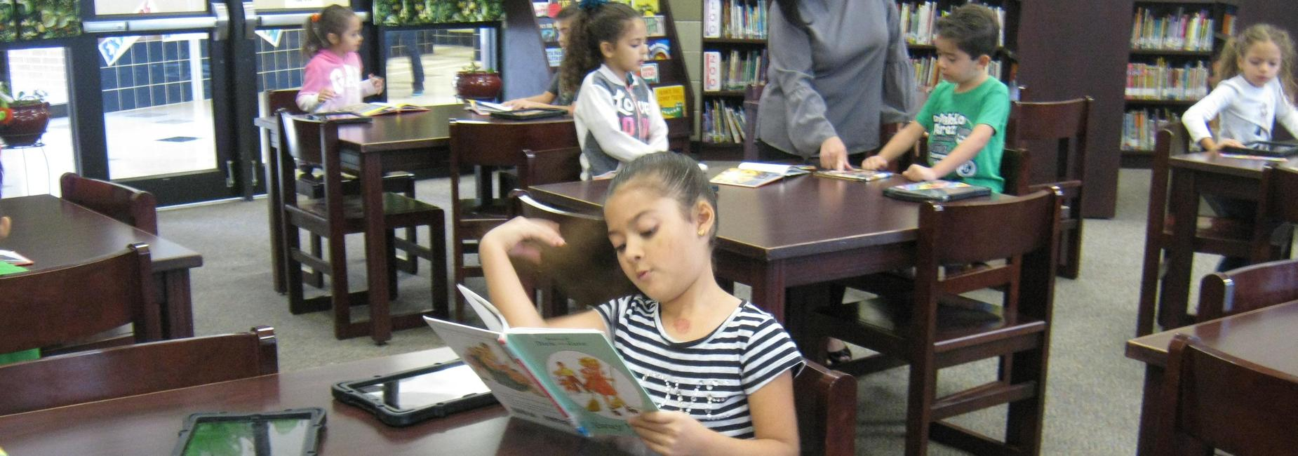 A student reading at the table.