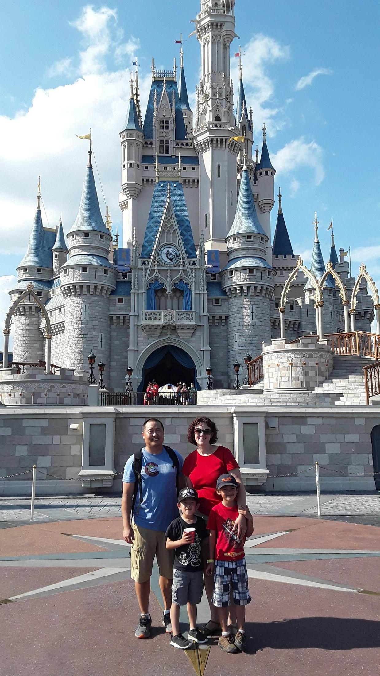 Family standing in front of Cinderella's Castle