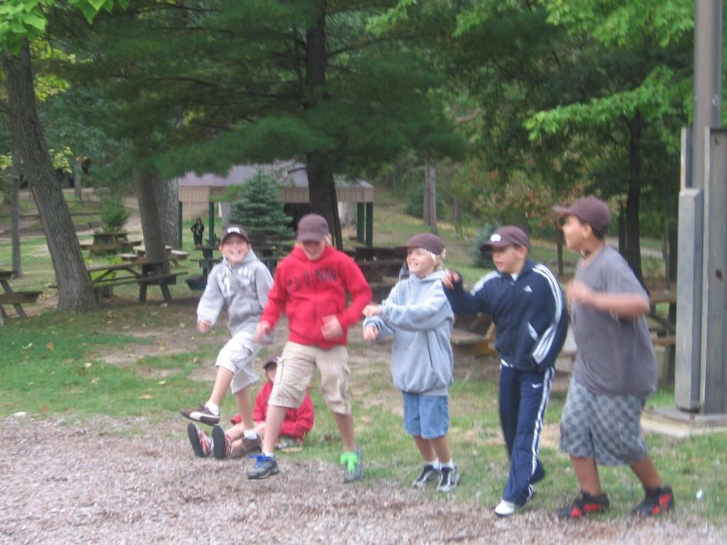 students in line playing game at camp