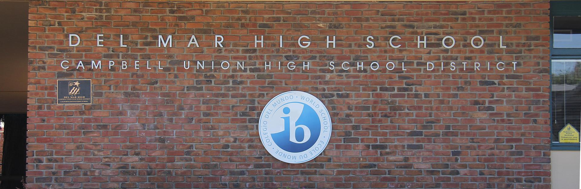 Image of front of Del Mar High School with IB World School Sign
