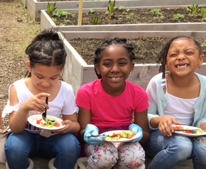 NBFA students enjoy salads made of vegetables from the school garden