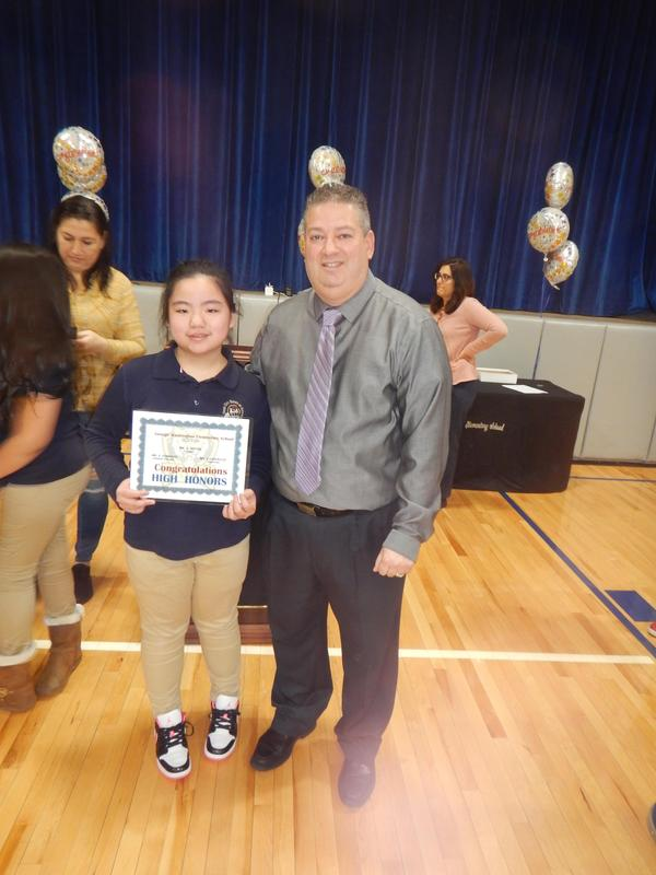Mr. Rivera and Girl holding up her Honors certificate