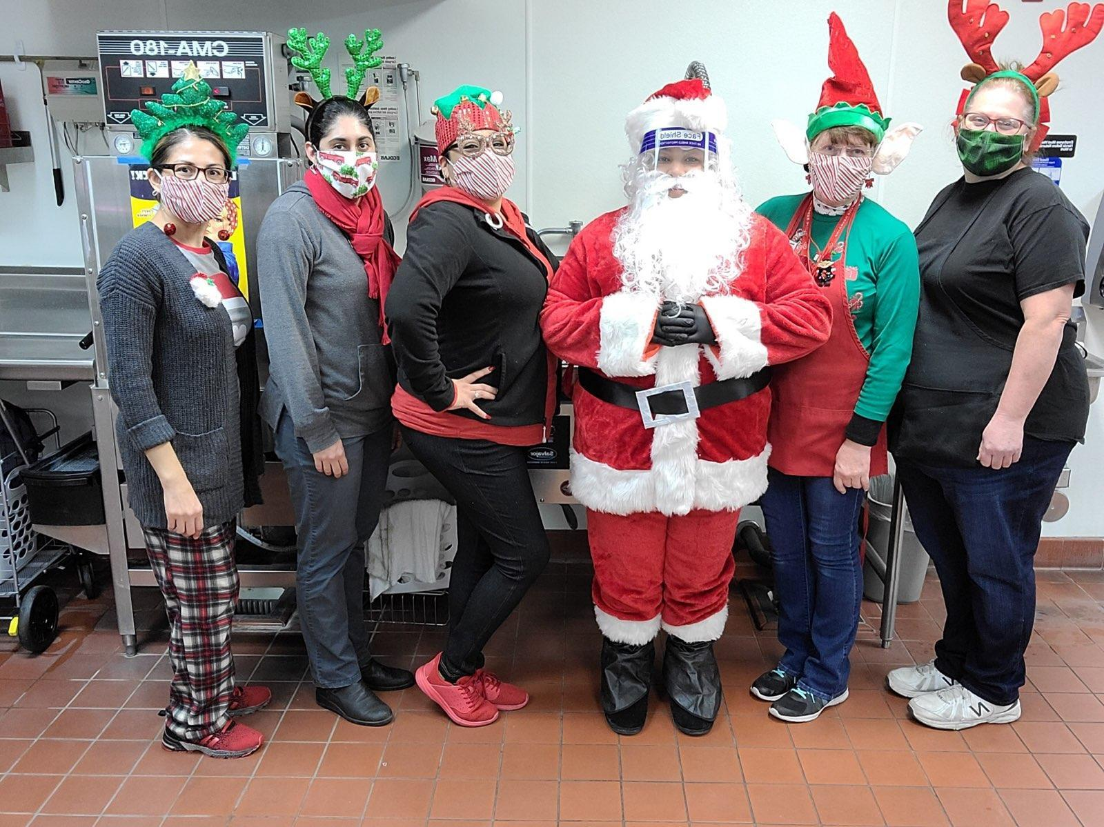 Cafeteria staff in Christmas outfits