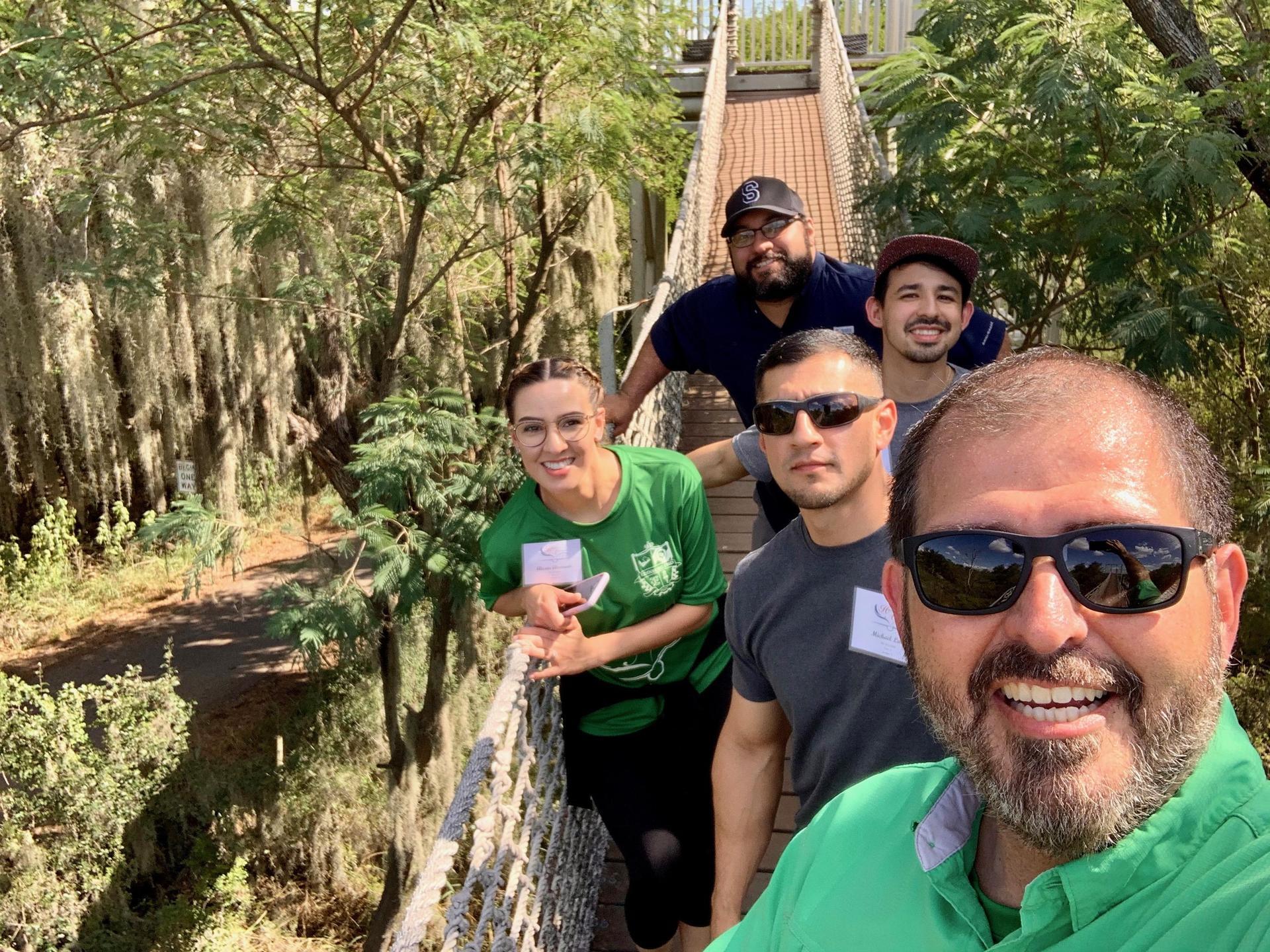 Group Photo of teachers on a bridge