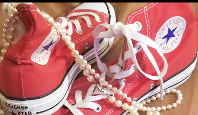 Red canvas high top sneakers and a string of pearls