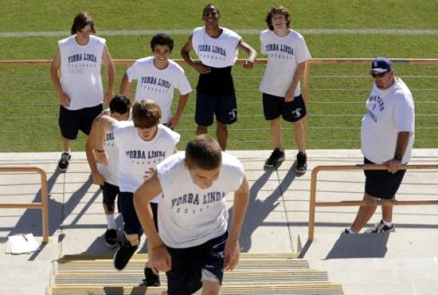 Football players running on the steps