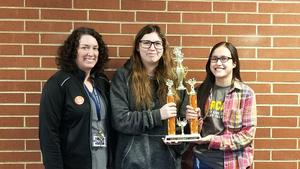Sydney Tomaskovich and Alexis Zavala with their trophy and advisor.