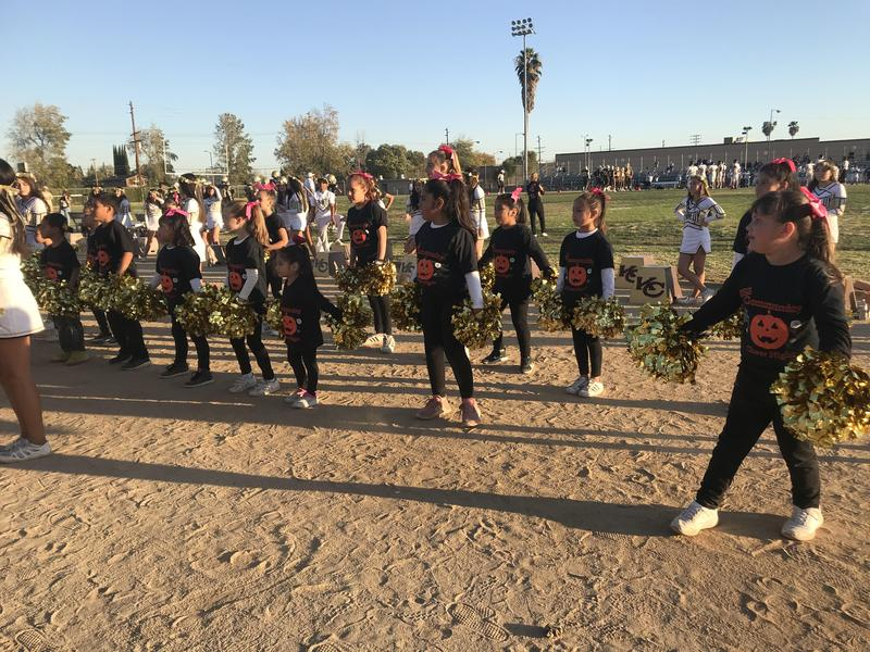 Kennedy Cheer Community Children Perform at Homecoming Football Game Featured Photo