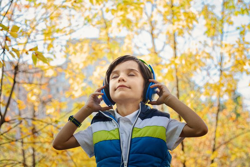 A boy listening to headphones