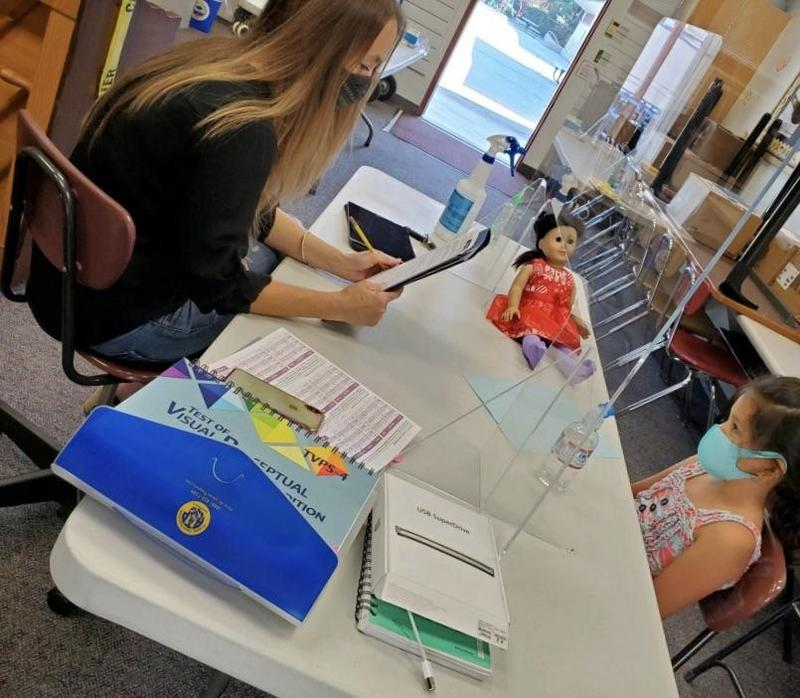School psychologist works with elementary student