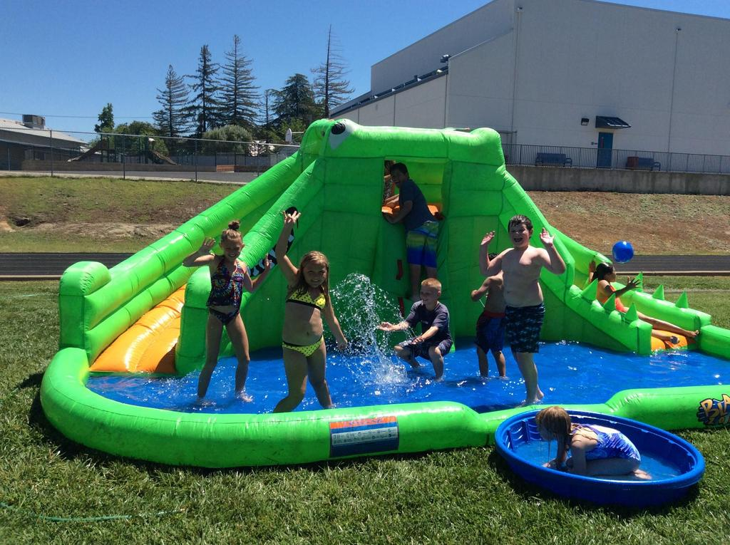 children playing in the inflatable water slide