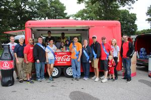 Grand Marshals and John Lessard in front of Coca-Cola Truck