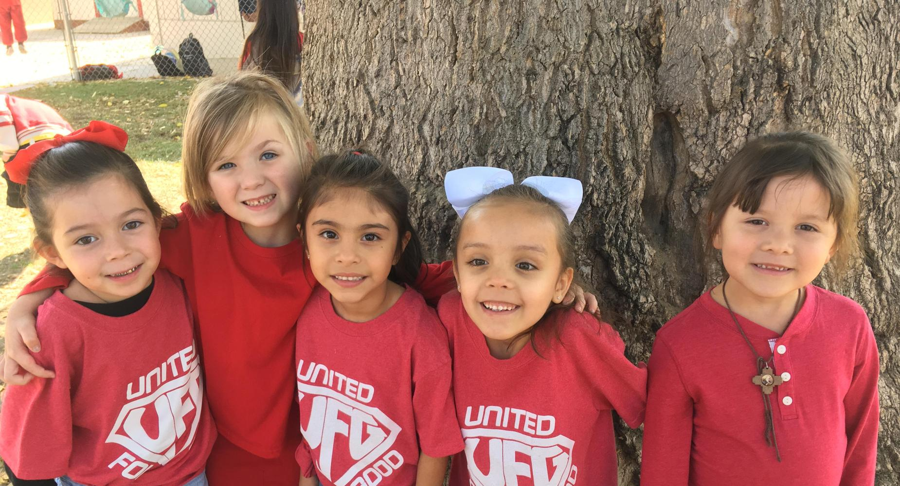 Students wearing United for Good Shirts