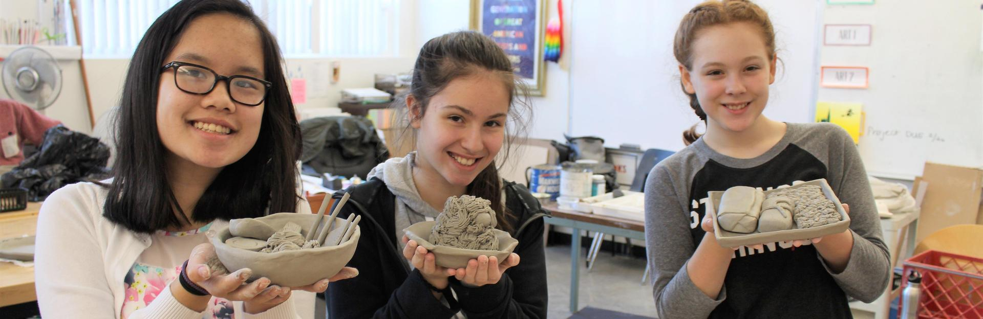 Junior High Art students with their clay food Spring 2018