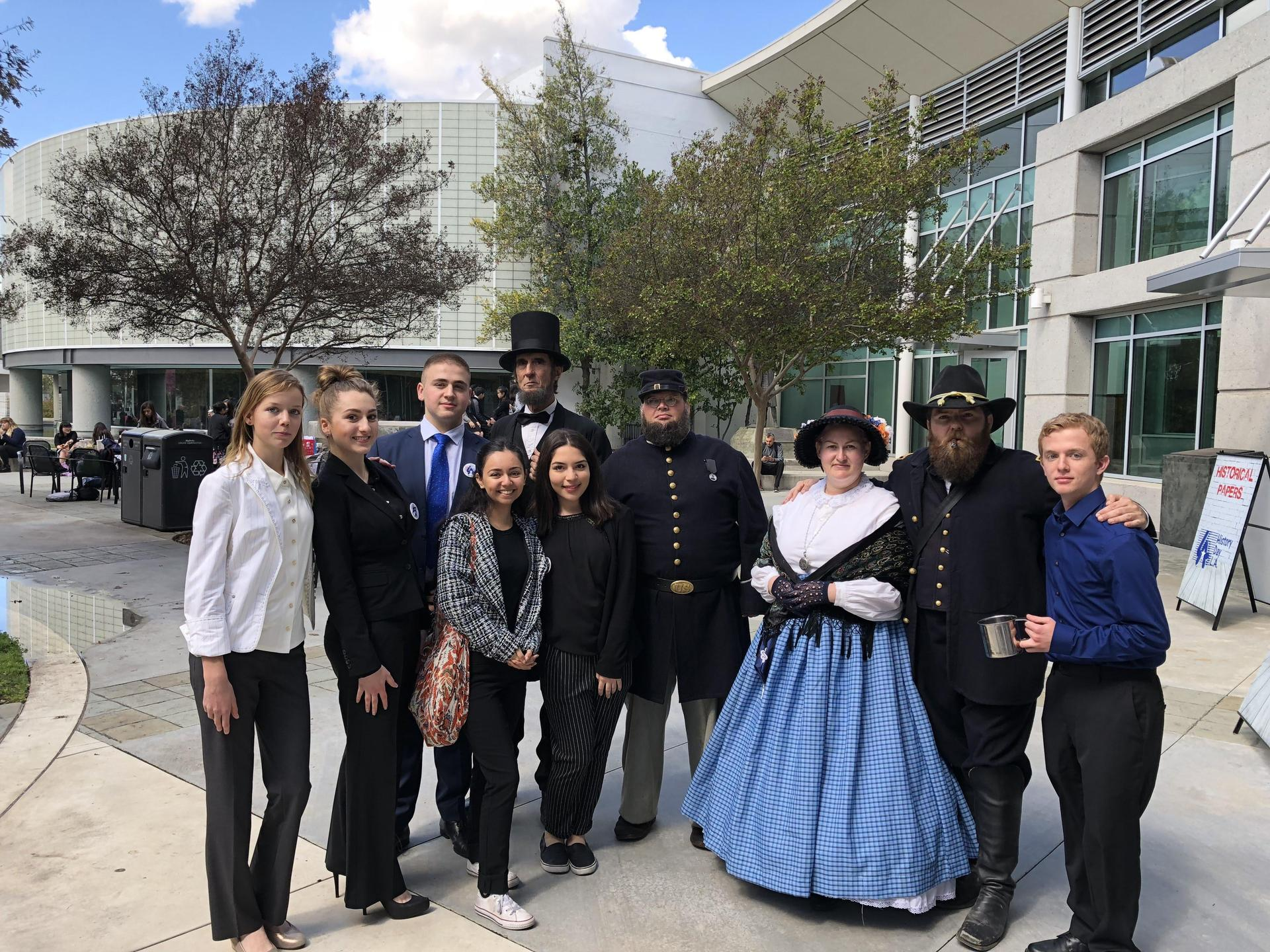 Group of students with people dressed in historical custom