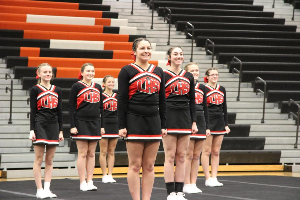 Cheerleaders standing in a gymnasium