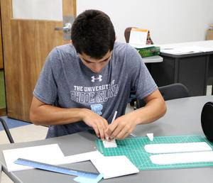 11th grader Christopher Giglio works on a pinhole camera in the new Innovation Classroom during Engineering and Design class at Westfield High School.