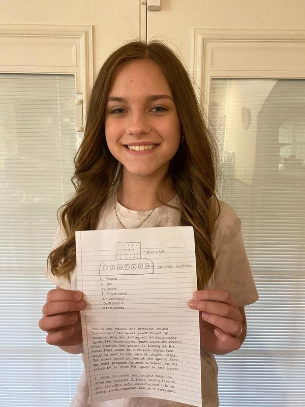 girl holding paper