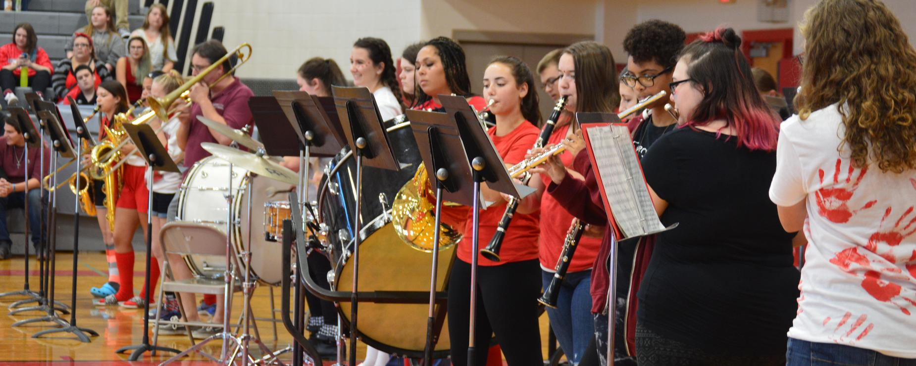 High school band students preforming at a pep rally