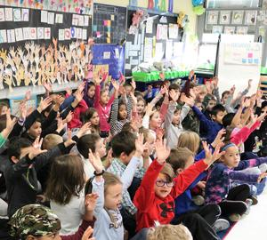 "First graders at Tamaques School in Westfield honored Dr. Martin Luther King, Jr by reciting a portion of his ""I Have a Dream"" speech and discussing the meaning of Dr. King's legendary oration at the March on Washington in August 1963.  ""It's like living your inside out,"" said one youngster when asked about a part of the speech where the civil rights leader said ""I have a dream that my four little children will one day live in a nation where they will not be judged by the color of their skin, but by the content of their character.""  Led by the 1st grade team of Linda D'Onofrio, Mary Montes, and Jenna Utman, the students also created a mural poster entitled ""Reach for the Highest Good.""  Pictured here is a side shot of the 1st graders assembled on a rug, reciting a portion of the speech."