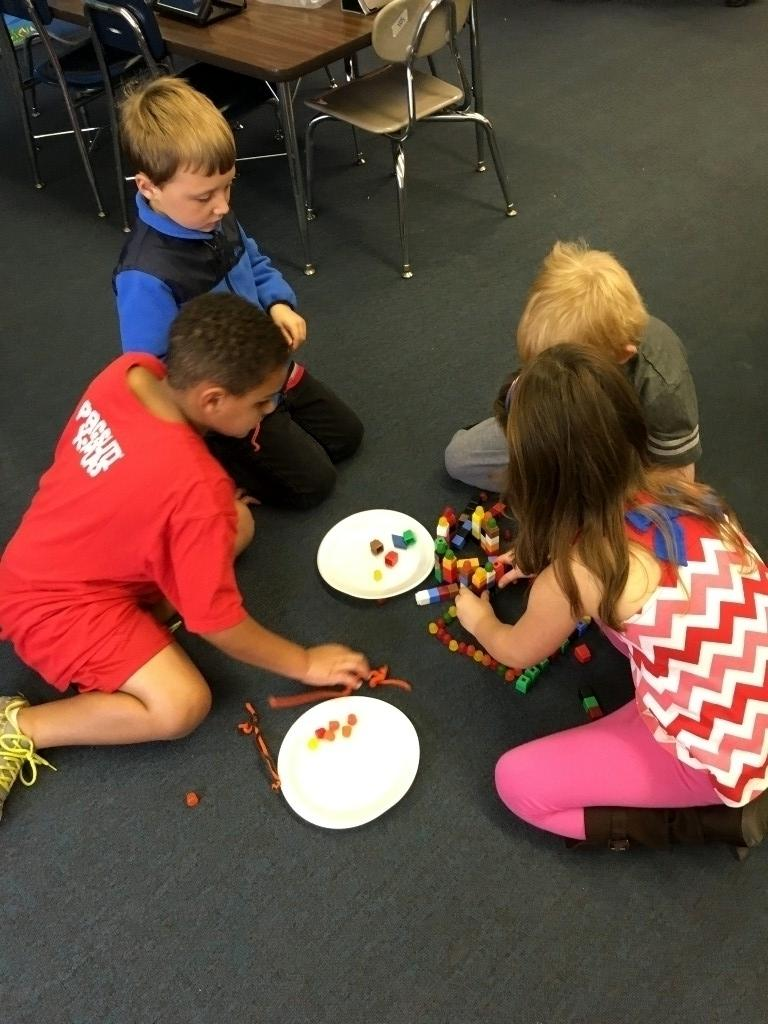 First graders math and cubes