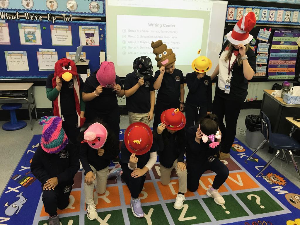 class and teacher wearing their crazy hats
