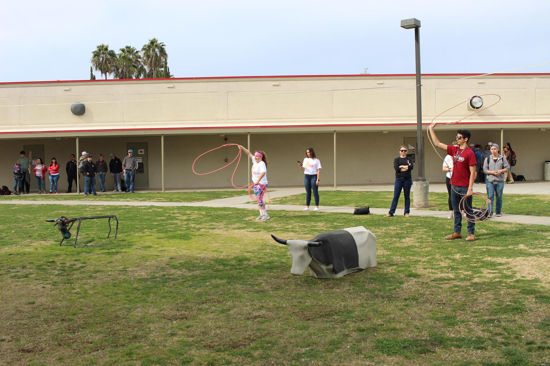 students and teachers practicing roping