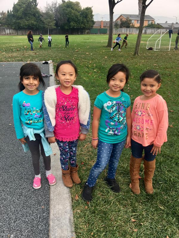 Students showing their shirts with kindness messages