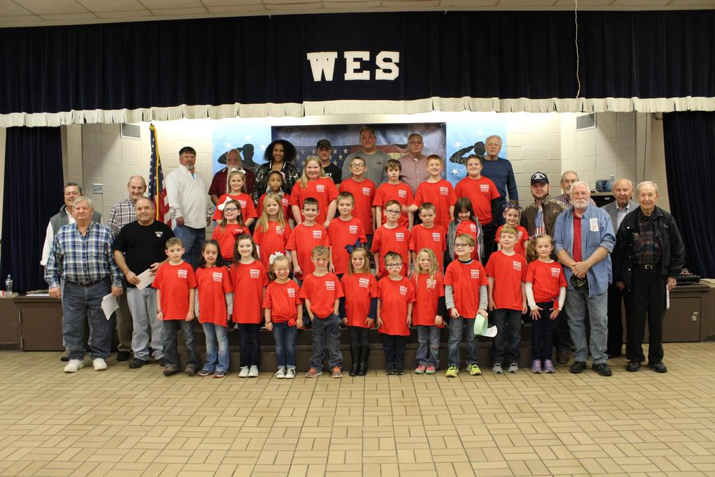 student council standing with veterans