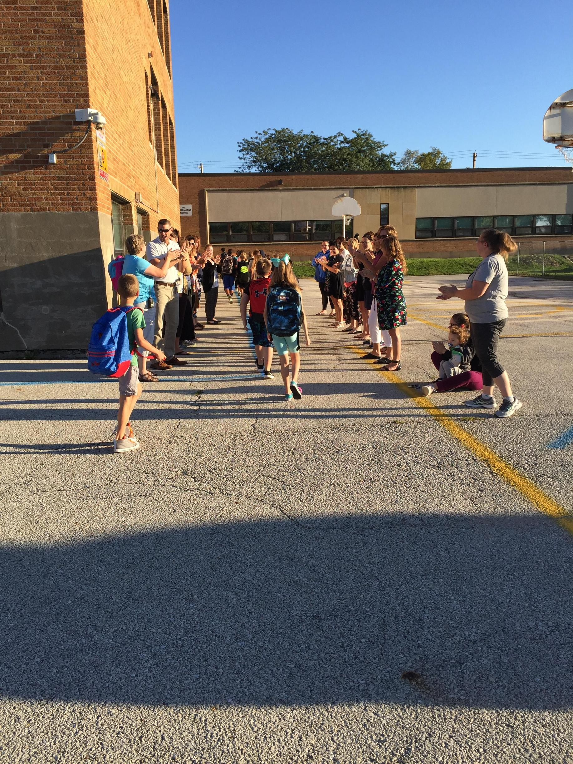 Roosevelt Elementary  students receiving a high five as they enter school.