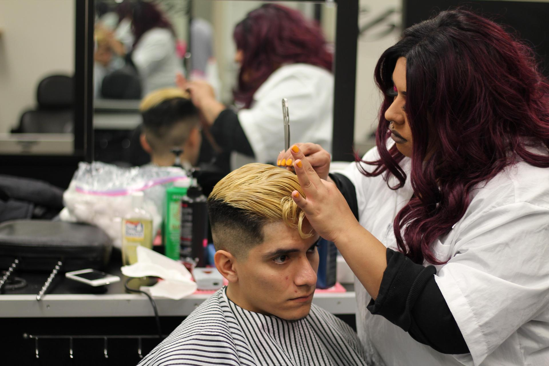 Barbering Students Showing Work